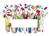 Large Group of Diverse Cheerful Multi-ethnic People Celebrating whit Flags Placard