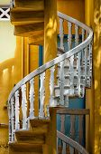image of balustrade  - white spiral stairs balustrades with yellow walls - JPG