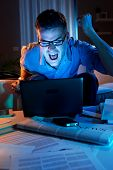 Angry Businessman Working At Home Until Late