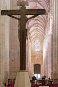Batalha, Portugal - March 03, 2013: Batalha Monastery. Crucifix and Altar seen from the Apse of the