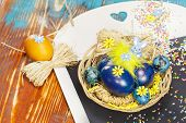 Easter eggs on vintage blackboard