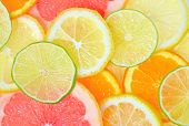 stock photo of fruits  - fresh Sliced citrus fruits background - JPG