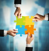 stock photo of merge  - Businessman with puzzle - JPG