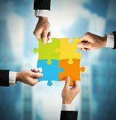 stock photo of partnership  - Businessman with puzzle - JPG