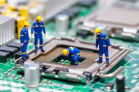 foto of cpu  - Group of construction workers repairing CPU - JPG