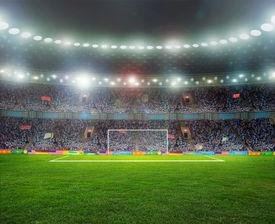 foto of light-pole  - Soccer ball on the field of stadium with light  - JPG