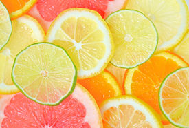 stock photo of flavor  - fresh Sliced citrus fruits background - JPG