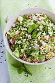 stock photo of tabouleh  - Tabouleh style salad made with millet and vegetables  - JPG
