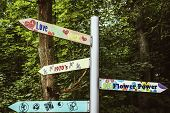stock photo of woodstock  - signpost with vintage messages from sixties and seventies