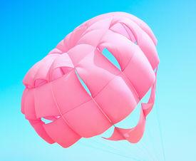 foto of parasailing  - Close up of pink parasailing on sky background - JPG