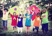 stock photo of kites  - Children Playing Kite Happiness Bonding Friendship Concept - JPG