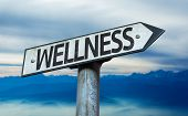 picture of sign board  - Wellness sign with sky background - JPG