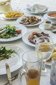 stock photo of piraeus  - Table in greek restaurant - JPG