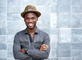 stock photo of single man  - Close up portrait of a happy young guy with hat - JPG
