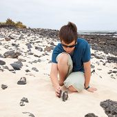 pic of ten years old  - building a cairn  - JPG