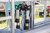 stock photo of teats  - Automated mechanized milking equipment closeup for farmland industry - JPG