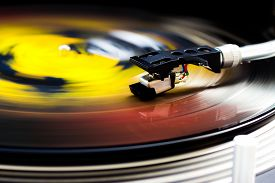 foto of lp  - DJ turntable with tonearm on a spinning color vinyl - JPG