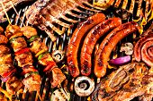 image of grilled sausage  - Assorted delicious grilled meat with vegetable over the coals on a barbecue - JPG