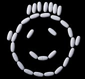 pic of oblong  - face of white oblong tablets on a black background - JPG