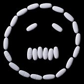 image of oblong  - face of white oblong tablets on a black background - JPG