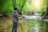 foto of fly rod  - Fisherman with fly - JPG