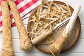 picture of grated radish  - peeled horseradish root on plate - JPG