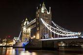 picture of london night  - The Tower bridge in London illuminated at night - JPG