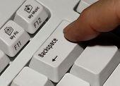 foto of backspace  - finger on the backspace key - JPG