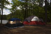 picture of nylons  - Two nylon tents at dusk at a campsite next to a lake - JPG