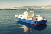 stock photo of old boat  - Old wooden pleasure boat anchored in Izmir bay Turkey - JPG