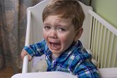 image of misbehaving  - little boy crying hysterically in his bed - JPG