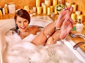 picture of bubble bath  - Woman relaxing at water in bubble bath - JPG