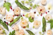 stock photo of norway lobster  - Presentation of a second dish of shrimp and asparagus tips - JPG