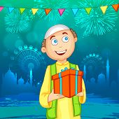 stock photo of eid festival celebration  - Happy Muslim boy with gift on shiny mosque silhouette background for Islamic festival - JPG