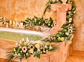 pic of bubble bath  - Home bathroom interior with flower and bubble bath - JPG