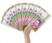 picture of colombian currency  - Peso bill held by a hand looking like a fan - JPG