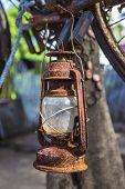 image of kerosene lamp  - Vintage Old Kerosene Lamp outdoors on a tree - JPG