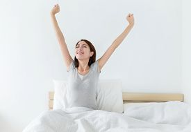 picture of japanese woman  - Attractive asian woman awaking on the bed - JPG