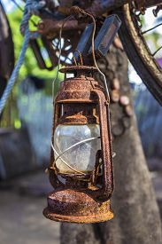 image of kerosene lamp  - Vintage Old Kerosene Lamp outdoors on a tree - JPG