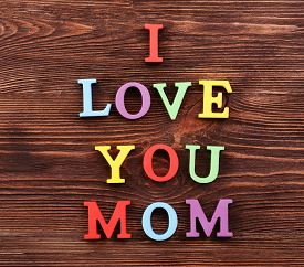 image of i love you mom  - Inscription I LOVE YOU MOM made of colorful letters on wooden background - JPG