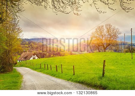 View of a spring day in the Switzerland, rural landscape at sunrise - \ Switzerland rural sunset land