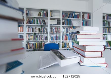 female student study in school library, using tablet and searching for informationâ??s on interne