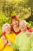 picture of elderly couple  - Senior couple with their daughter outdoors - JPG