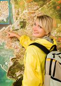 Happy tourist near the map poster