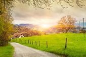 Постер, плакат: View of a spring day in the Switzerland rural landscape at sunrise  Switzerland rural sunset land