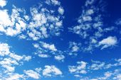 stock photo of clouds sky  - clouds in the sky drifting away in a light breeze - JPG