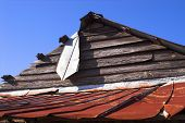 stock photo of tobacco barn  - an old dilapidated wooden tobacco barn roof - JPG