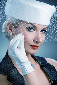 stock photo of beautiful young woman  - Beautiful young woman in white hat with net veil - JPG