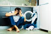 stock photo of kitchen appliance  - Concept Man stressed on the kitchen floor - JPG
