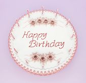 stock photo of birthday-cake  - Top view of birthday cake with candles and roses with greetings words - JPG